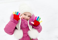 Portrait of smiling little girl in winter day Royalty Free Stock Photo