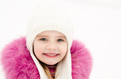 Portrait of smiling little girl in winter day Royalty Free Stock Image