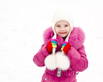 Portrait of smiling little girl in winter day Stock Photos