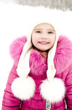 Portrait of smiling little girl in winter day Royalty Free Stock Images