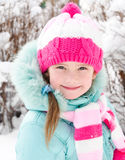 Portrait of smiling little girl in winter Royalty Free Stock Photo