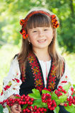 Portrait of a smiling little girl in a wreath, in the national Ukrainian Hutsul costume Royalty Free Stock Photo