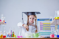 Portrait of smiling little scientist in laboratory Stock Photography