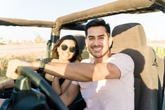 Nothing Beats A Road Trip With Good Company. Portrait of smiling lovers enjoying road trip together royalty free stock image