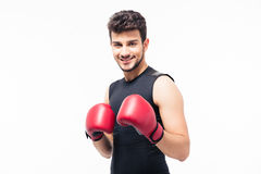Portrait of a smiling male boxer with red gloves Stock Photo