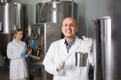 Portrait of smiling male brewery worker. On beer production factory Stock Photography