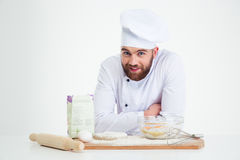 Portrait of a smiling male chef cook baking Royalty Free Stock Photography