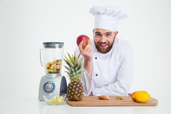 Portrait of a smiling male chef cook with fruits Royalty Free Stock Image