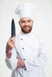 Portrait of a smiling male chef cook showing knife Royalty Free Stock Photo