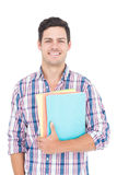 Portrait of smiling male college student holding books. On white background Royalty Free Stock Photos
