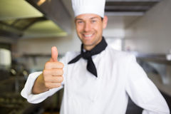Portrait of a smiling male cook gesturing thumbs up Royalty Free Stock Image