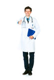 Portrait of a smiling male doctor holding a notepad and finger u Royalty Free Stock Photos