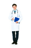 Portrait of a smiling male doctor holding a notepad and finger u Royalty Free Stock Photography