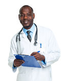 Portrait of a smiling male doctor writing in the notepad on whit Stock Photography
