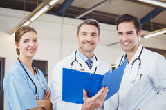 Portrait of smiling male doctors holding clipboards while working Royalty Free Stock Photography