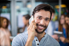 Portrait of smiling male executive talking on mobile phone Royalty Free Stock Photos