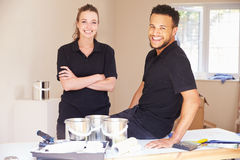 Portrait of smiling male and female decorators Royalty Free Stock Photo