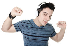 Portrait of a smiling male with headphones posing Royalty Free Stock Images