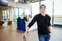 Portrait Of Smiling Male Passenger At Airport Royalty Free Stock Photo