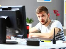 Portrait of smiling male photo editor using computer Stock Photo