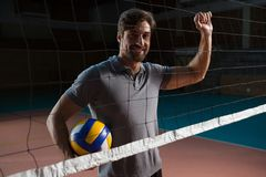 Portrait of male player holding volleyball Stock Photography