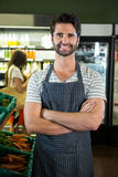 Portrait of smiling male staff standing with arms crossed in organic section Stock Images