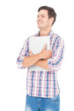 Portrait of smiling male student holding a laptop. On white background Royalty Free Stock Image