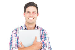 Portrait of smiling male student holding a laptop. On white background Stock Photo