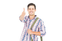 Portrait of smiling male student showing a thumbs up. On white background Royalty Free Stock Image