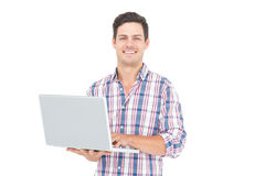 Portrait of smiling male student using a laptop. On white background Royalty Free Stock Photography