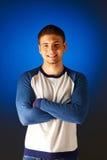 Portrait of smiling man against blue Stock Photo