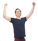 Portrait of a smiling man with arms raised in success. Isolated on white background Stock Images