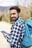 Portrait of smiling male hiker with backpack stock photography