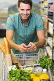 Portrait of smiling man buy a food and using his smartphone Royalty Free Stock Photo