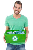 Portrait of a smiling man carrying recycle container Stock Photos