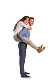 Portrait of smiling man carrying woman Stock Photo