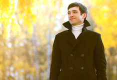 Portrait smiling man in coat outdoors in autumn park Stock Images