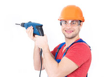A man drilling a hole in the wall. Stock Images