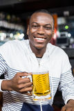 Portrait of smiling man drinking a beer Stock Image