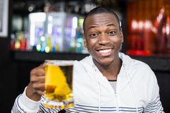 Portrait of smiling man drinking a beer Stock Images