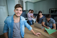 Portrait of smiling man with friends in background Stock Photography