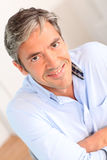Portrait of smiling man with grey hair Stock Photography