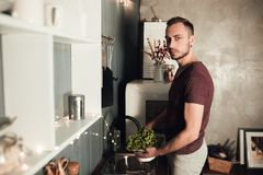 Man in the kitchen. Cooking time. Rustic color lifestyle photo. People and healthy eating concept. Guy in sport home stock photos