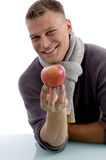 Portrait of smiling man holding apple Stock Images