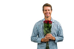 Portrait of smiling man holding bouquet of roses Stock Image