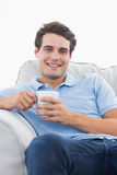 Portrait of a smiling man holding a cup of coffee Royalty Free Stock Photo