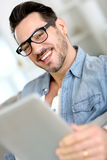 Portrait of smiling man holding a digital tablet Royalty Free Stock Photography