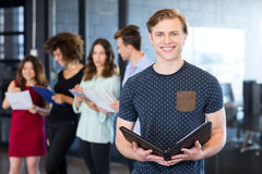 Portrait of smiling man holding a document Royalty Free Stock Image