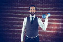 Portrait of smiling man holding dumbbell Royalty Free Stock Photo