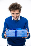 Portrait of a smiling man holding gift Royalty Free Stock Photos